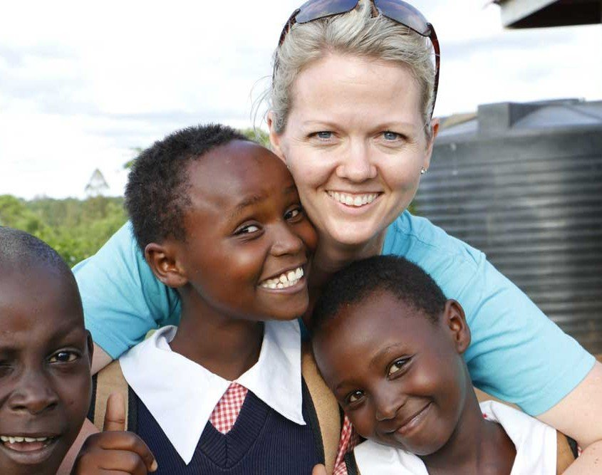 Amy Churchill holding orphans