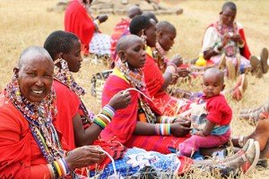 Maasai women making paper beads