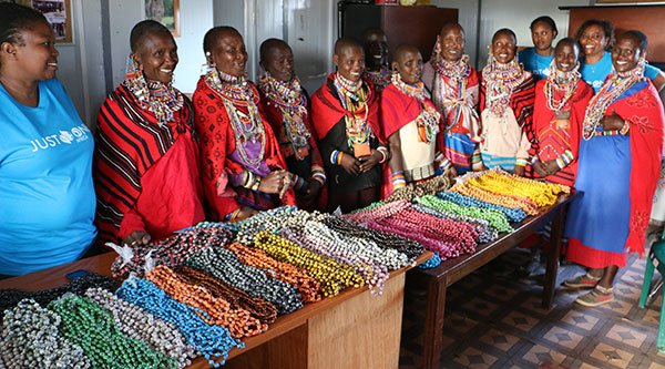 Beautiful Maasai women selling their handmade paper beads