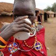 Maasai woman drinking clean water from a Just One Africa filter in Amboseli