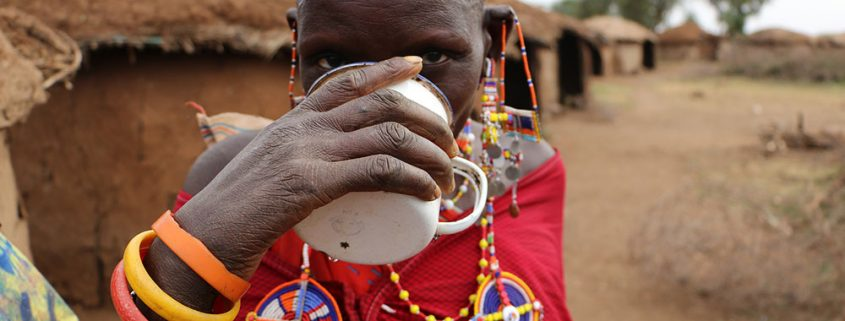 Masai woman drinking clean water from a Just One Africa filter in Amboseli