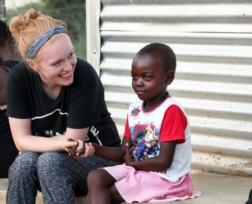 Lexie and child at orphanage