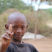 A student at Lenkai Christian School. He is Just One!