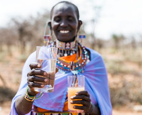 Clean and Dirty Water with Masai Woman in Amboseli, Kenya