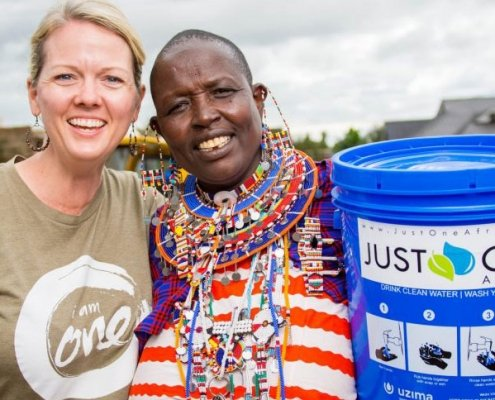 Amy Churchill with Maasai women in Kimana, Kenya at a water filter distribution.