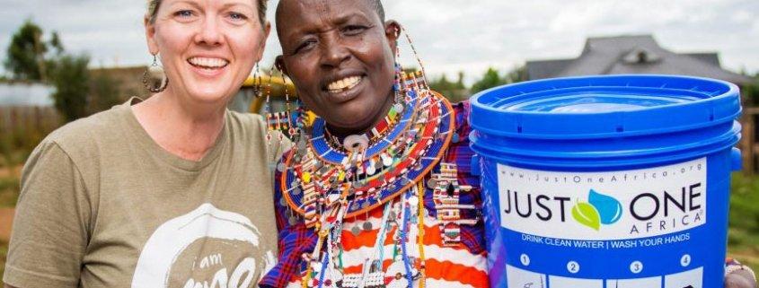 Amy Churchill with Maasai women in Kimana, Kenya at a water filter distribution.